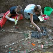 Forensic anthropologists uncovering human remains