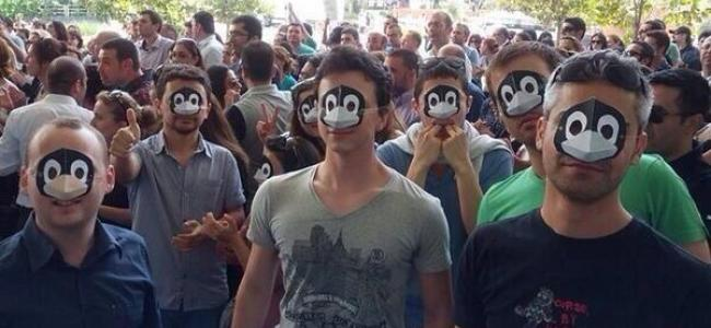 Protesters in Turkey wearing penguin masks
